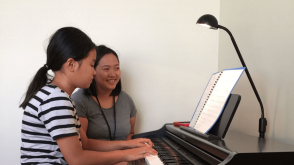 Our singing and piano teacher giving a piano lesson in our Gladstone Park Studio